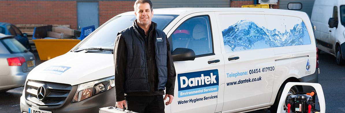 BS 8558 Chlorination - Dantek Engineer In Front Of Van