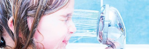 Child Pours Water From The Shower